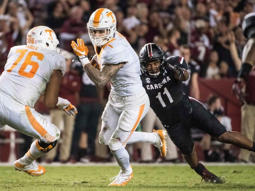 Tennessee running back Jalen Hurd (1) attempts to elude