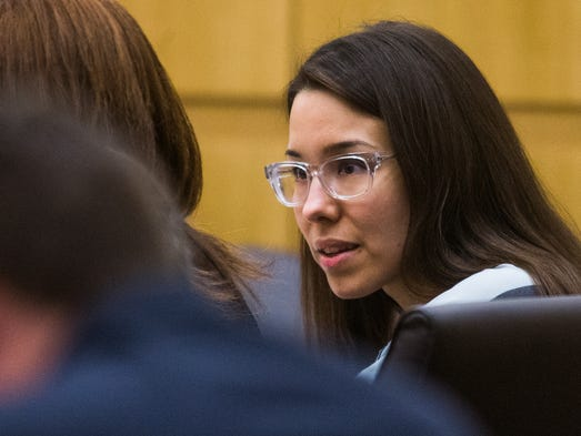 Jodi Arias looks at her defense attorney, Jennifer Wilmott, during a hearing in Maricopa County Superior Court in Phoenix on Aug. 13, 2014.