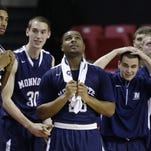 Members of the Monmouth basketball team watch from the bench in the final moments of an NCAA college basketball game against Maryland, Friday, Nov. 28, 2014, in College Park, Md. Maryland won 61-56. (AP Photo/Patrick Semansky)