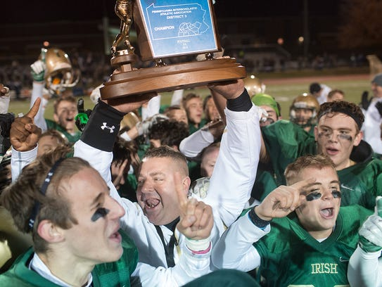 York Catholic head coach Eric Depew celebrates their
