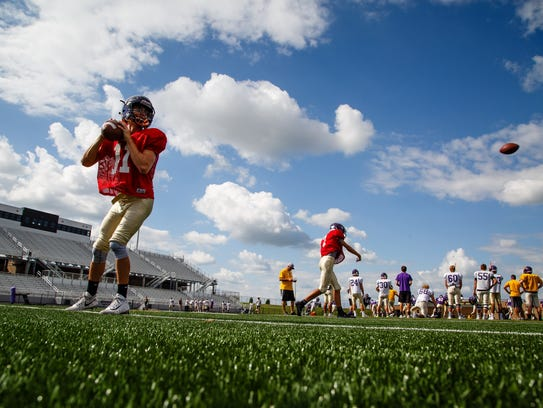 Football players practice at Johnston's new football