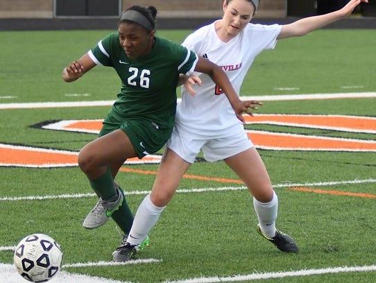 Novi's Lauren Calhoun (left) tries to manuever past