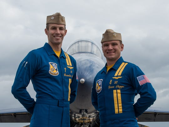 Blue Angels pilots, Lt. Brandon Hempler, left, and Lt. David Steppe pose for a photo in front of their Boeing F/A-18 Hornet at Wallops Flight Facility on Tuesday, Nov. 29, 2016.