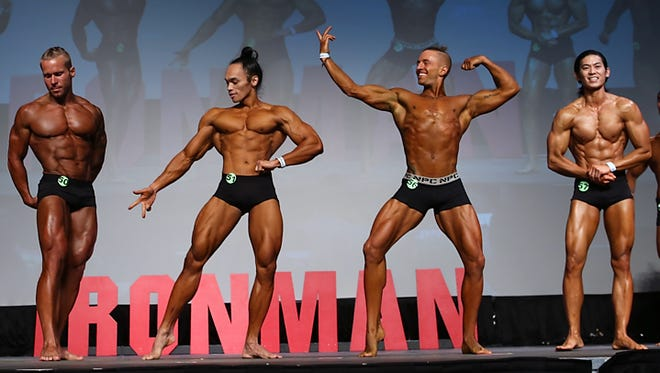Russky Peru, second from left, and Dr. Joseph Dimalanta, far right, competed in the 2017 National Physique Committee Washington IronMan Natural Bodybuilding Championships in Seattle, WA.