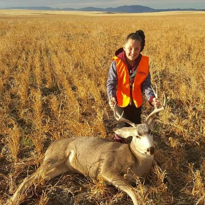 Taylor Whitfield got this mule deer on her first hunt.