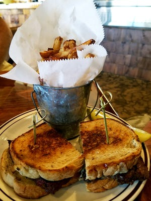 The Harvest Table's meatloaf melt topped with tomato jam, grilled onions, horseradish cheddar, and a house demi-glace on grilled thick cut rye bread. All sandwiches come with a choice of house-made coleslaw, potato salad or fresh fruit. You also can order a side of hand cut fries for $3.