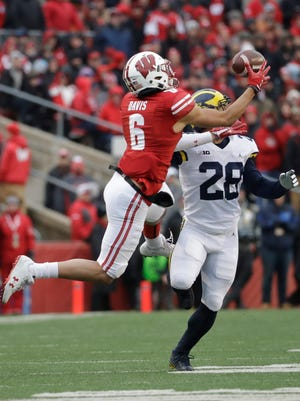 Wisconsin's Danny Davis catches a pass in front of Michigan's Brandon Watson during the second half of an NCAA college football game Saturday, Nov. 18, 2017, in Madison, Wis.