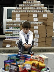 Carter Boles, shown at 8 during a canned-food drive
