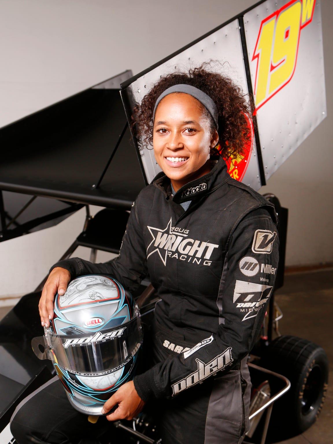 Driver Sara Elrod with her micro sprint car Tuesday,