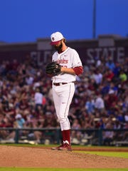 Jim Voyles (42) prepares to pitch at the top of the