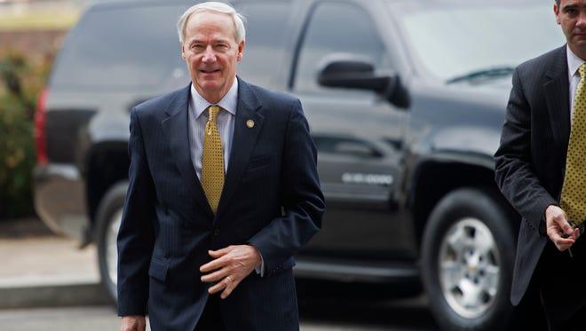 Arkansas Gov. Asa Hutchinson arrives at the National Governors Association Winter Meeting in Washington, Sunday, Feb. 21.