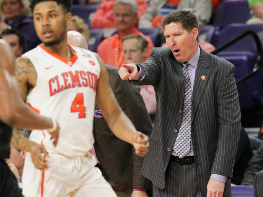 Clemson head coach Brad Brownell  communicates near