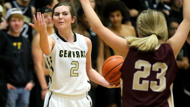 Central Magnet School's Jaci Sullivan instructs her teammates to move up as Sullivan is guarded by Cannoon County's Erin McReynolds on Friday, Dec. 5, 2014., at Central.