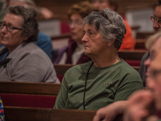 Citizens of Richmond, ind., listen during a forum on