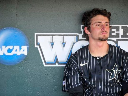Vanderbilt's Rhett Wiseman sits in the dugout prior to the Virginia game in the College World Series at TD Ameritrade Park, Monday, June 22, 2015, in Omaha, Neb.