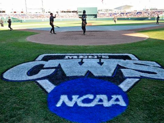 Vanderbilt players warm up prior to the Virginia game in the College World Series at TD Ameritrade Park, Monday, June 22, 2015, in Omaha, Neb.