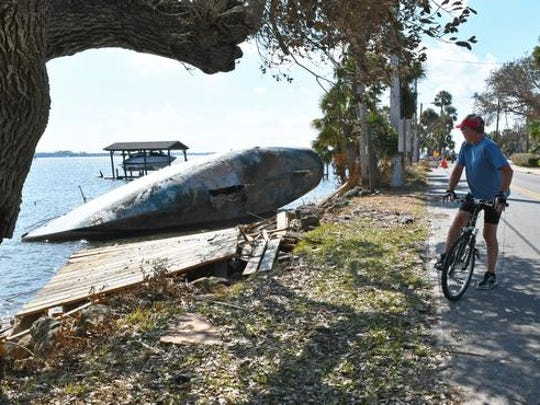 A large boat washed up on it's side in Rockledge. Damage to boats, docks, trees, boat houses, and more along the Indian River in Cocoa and Rockledge on the Sunday after Hurricane Irma first hit the Space Coast.