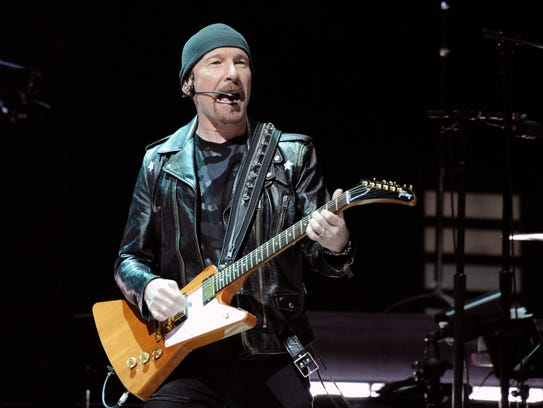 """U2 guitarist The Edge performs during the band's """"Experience"""