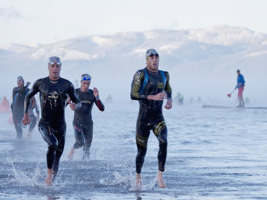 Competitors head out of the water in the swim portion