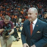 New Virginia Tech men's basketball coach Buzz Williams enters Cassell Coliseum Monday for his press conference.