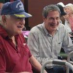Military veteran Bob Burnley, left, and U.S. Sen. David Vitter share a laugh before the program begins. Vitter speaks at the War Veterans Home as part of the Chennault Aviation and Military Museum's Spirit of '45 celebration.