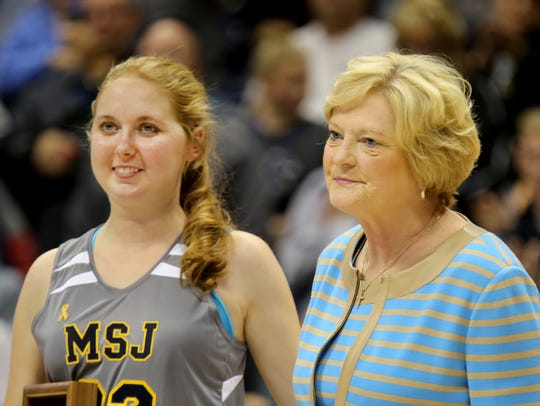 Lauren Hill (left) was awarded the Pat Summitt Most