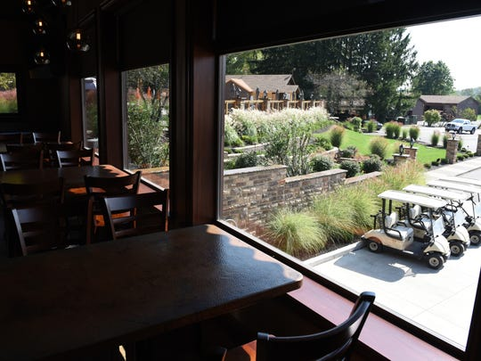 Trout Club dining area of the TC Lounge overlooking the golf carts.