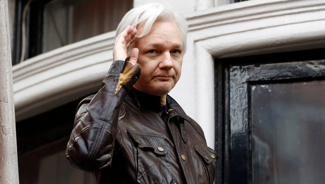 In this May 19, 2017 file photo, WikiLeaks founder Julian Assange greets supporters from a balcony of the Ecuadorian embassy in London.