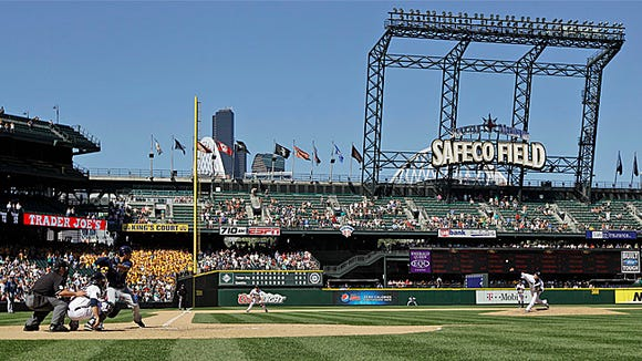 Seattle Mariners pitcher Felix Hernandez, right, pitches in his 2012 perfect game at Safeco Field. The Bakersfield Blaze announced it will be the Single-A affiliate of the Mariners. (AP Photo/Ted S. Warren)