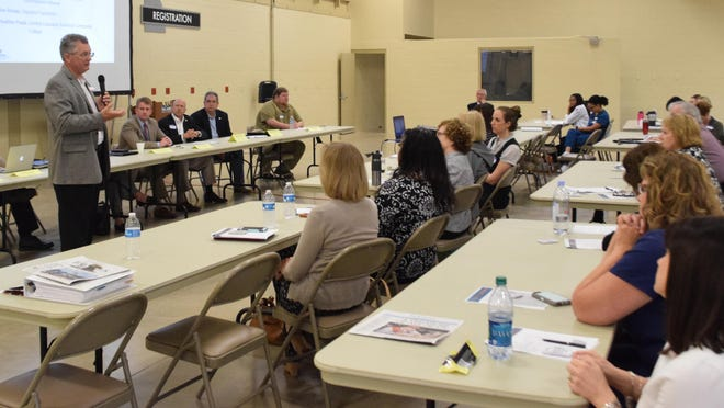Joe Rosier, president and chief executive officer of The Rapides Foundation, address those gathered for a community health assessment meeting Thursday at the state's megashelter located near LSUA.