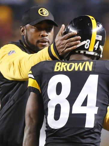 Steelers head coach Mike Tomlin congratulates wide