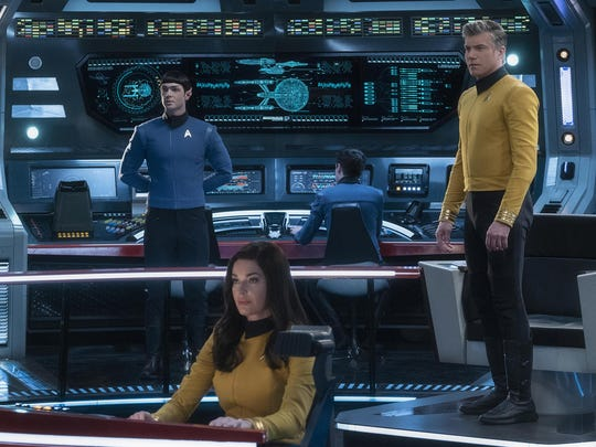 "This image released by CBS All Access shows, from left, Ethan Peck as Spock, Rebecca Romijn as Number One, and Anson Mount as Captain Pike of the the CBS All Access series ""Star Trek: Strange New Worlds."" CBS All Access is bringing back Spock for its third full live action show in the ""Star Trek"" universe, ordering a new series set in the years before Capt. James T. Kirk helmed the U.S.S. Enterprise."