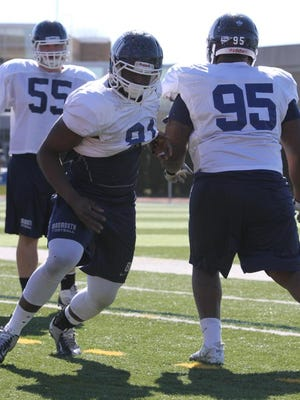 Darnell Leslie (91) opened spring practice with his Monmouth University teammates on Wednesday after missing all of last season due to injury