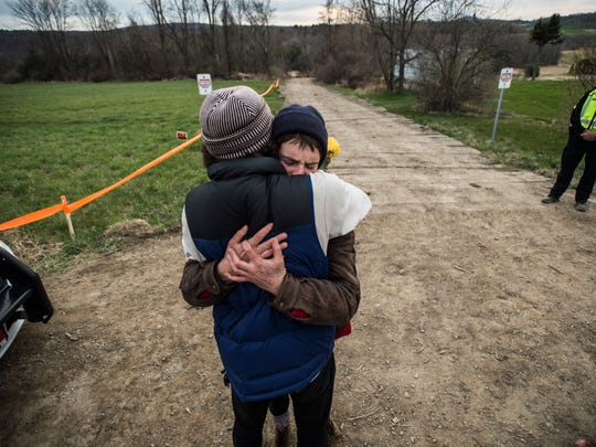 Addie Herbert embraces a friend Friday night after spending two weeks suspended in a tree over the Vermont Gas pipeline route in Monkton.