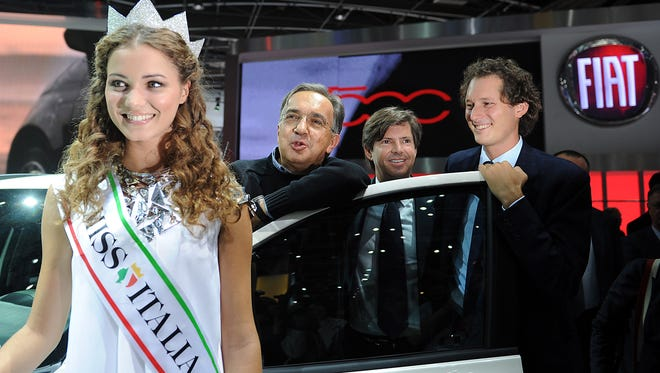 John Elkann, from right, joins Olivier Francois and  Sergio Marchinne for an event with Miss Italia Giusy Buscemi at the Paris Motor Show in 2012