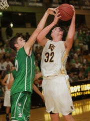 Fort Myers' Mark Matthews defends against Bishop Verot's Ricky Doyle in 2013.