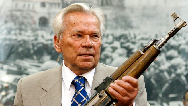 Mikhail Kalashnikov holds his AK-47 Nr.1, a prototype of the famous AK-47 rifle, during a ceremony in June 2007 to mark the 60th anniversary of the assault rifle's in the Russia's Armed Forces Central Museum in Moscow.