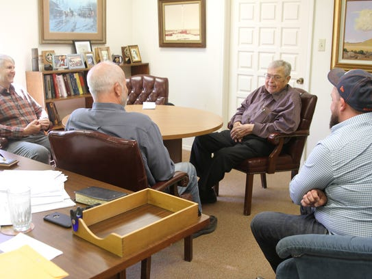 John Alexander, left, Kurt Fagrelius, Tom Dugan and Sean Dugan talk about the Dugan Production Corp. at their office in Farmington earlier this year.