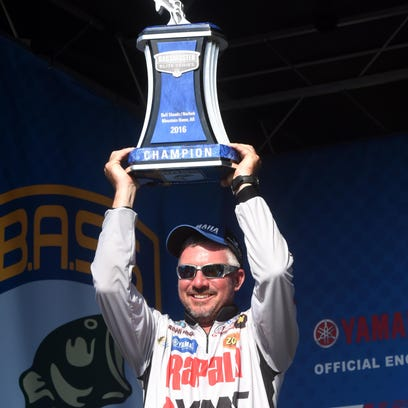Randall Tharp holds up his two biggest bass on Sunday, after winning the Bassmaster Elite Series tournament on Bull Shoals and Norfork lakes with a catch of 61 pounds, 10 ounces.