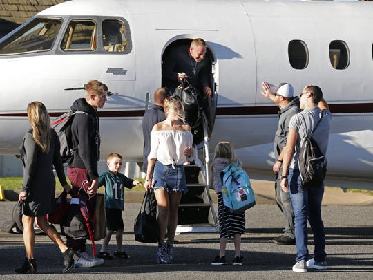 Eric Casaburi exits a plane Friday at Monmouth Jet Center in Wall, after flying his family out of Florida to avoid Hurricane Irma.