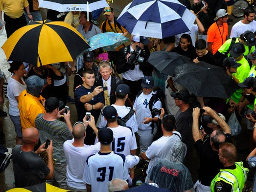 Vanderbilt baseball head coach Tim Corbin is greeted by fans as he arrives at Hawkins Field with the NCAA National Championship trophy Thursday June 26, 2014, in Nashville, Tenn.