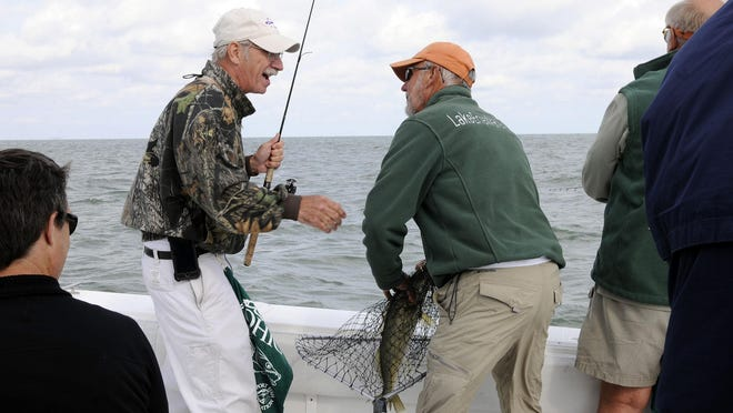Mike Budzik of Logan reacts after catching his first walleye of the day with Captain Rick Dunlap during the 36th annual Governor's Fish Ohio Day on Wednesday.