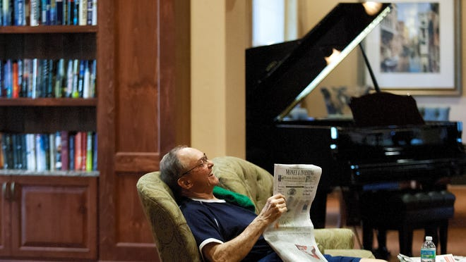 """""""Lovely,"""" is how John Guidon describes living at The Terraces at Bonita Springs while relaxing Thursday in the community's library. """"It can't be all bad if all you have to do is chew and swallow,"""" joked Guidon."""