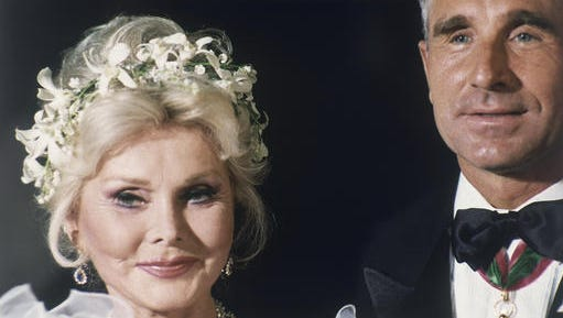FILE- In this Aug. 14, 1986, file photo, Zsa Zsa Gabor and her eighth husband Frederic Prinz von Anhalt are seen at her home in the Bel Air section of Los Angeles after their wedding. Anhalt is defending himself in an article published online by People magazine Jan. 12, 2017, for keeping his late wife's ashes at his home instead of interring them at a cemetery.