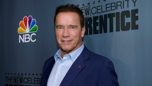 "This Dec. 9, 2016 image released by NBC shows Arnold Schwarzenegger, the new boss of ""The New Celebrity Apprentice,"" at a press junket in Universal City, Calif.  Schwarzenegger said Friday that he's through with ""The New Celebrity Apprentice,"" and he's blaming President Donald Trump for the television reality show's recent poor performance. The former California governor said he wouldn't mind working with NBC and producer Mark Burnett again ""on a show that doesn't have this baggage."""
