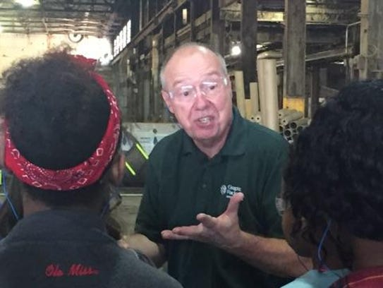 Charles Leggieri talks to students touring Graphic