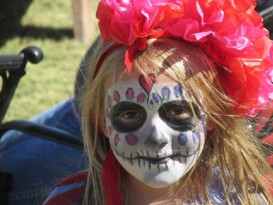 A young girl celebrates Dia de Los Muertos in Lincoln