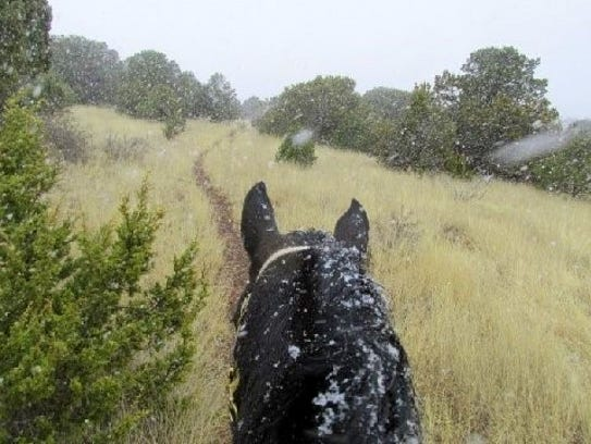 Snow begins to fall on a ride in the mountains.