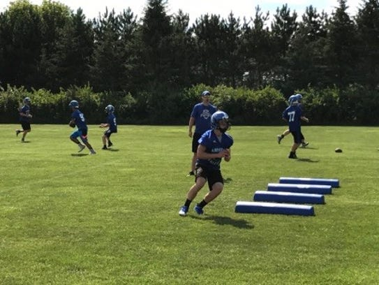 Prospective wide receivers go through a pass-catching
