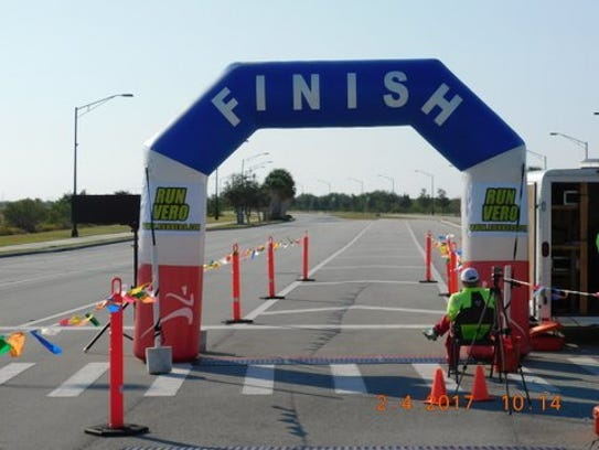 An attendant waits for runners in the Treasure Coast